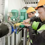 engineers working on piping